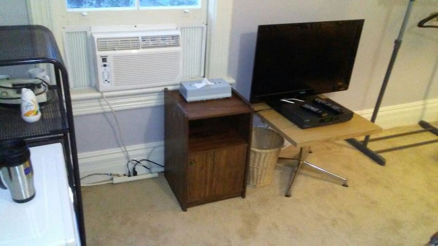 Air-conditioner, cable t.v.& sundry storage