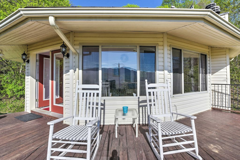 Step outside to find a wrap-around porch with rocking chairs and breathtaking views.