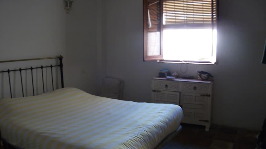 Bedroom 1, window to quiet patio