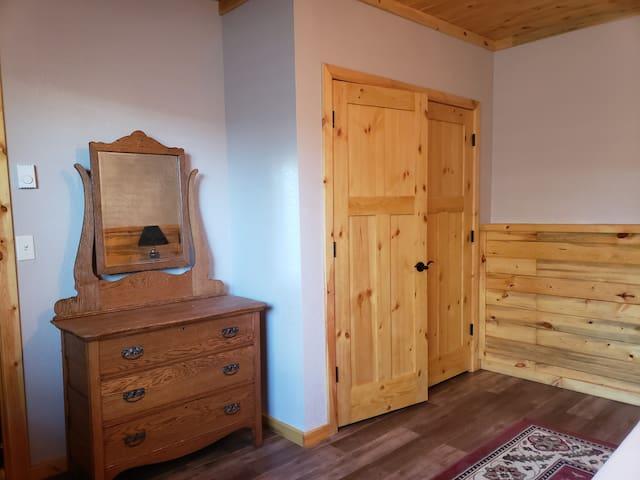 Bedroom closet & dresser.