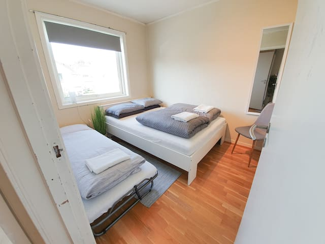 Guest bedroom with one comfortable double bed and a single bed