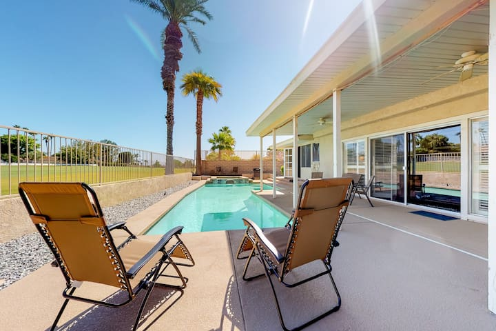 Updated home w/ a golf course view, putting green, private pool & spa