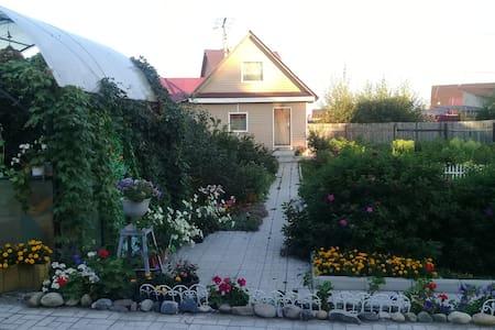 A cottage with a beautiful garden near Irkutsk