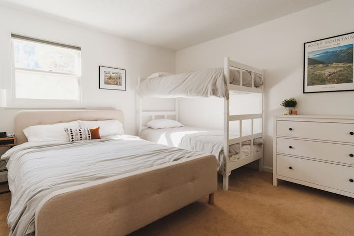 Bedroom 1 with a queen and two bunk beds.  Get a good night's sleep in premium linens and new foam mattresses