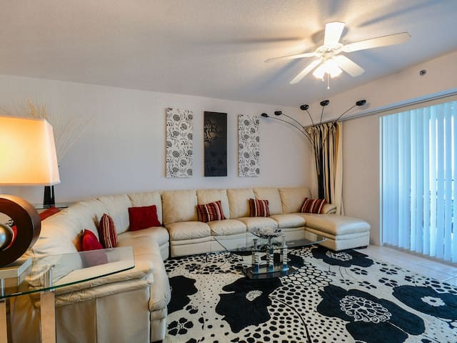 Lovely living room with leather wrap around couch, HD TV, DVD and access to the private balcony.