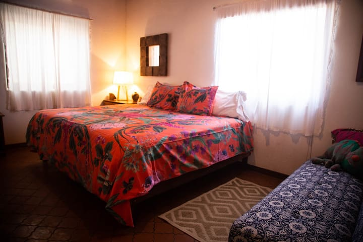 Romantica, upstairs in Main House, king bed (or two twins), sofa, AC, shared bath with Veranda.