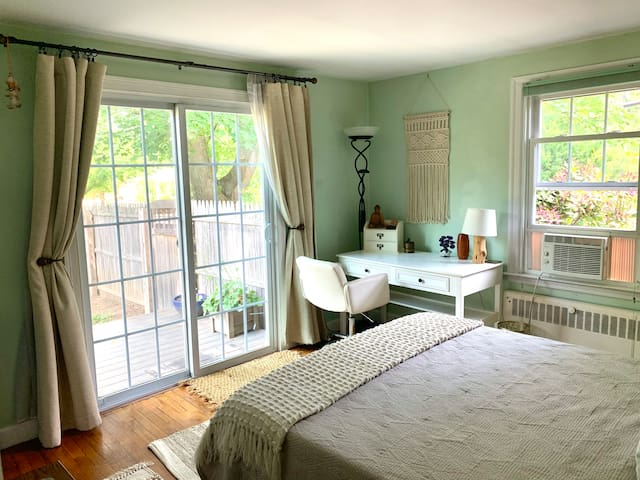 Downstairs bedroom #2 withe private entrance / sliding doors to the garden and it's own private deck.  This room has a desk but no dresser.
