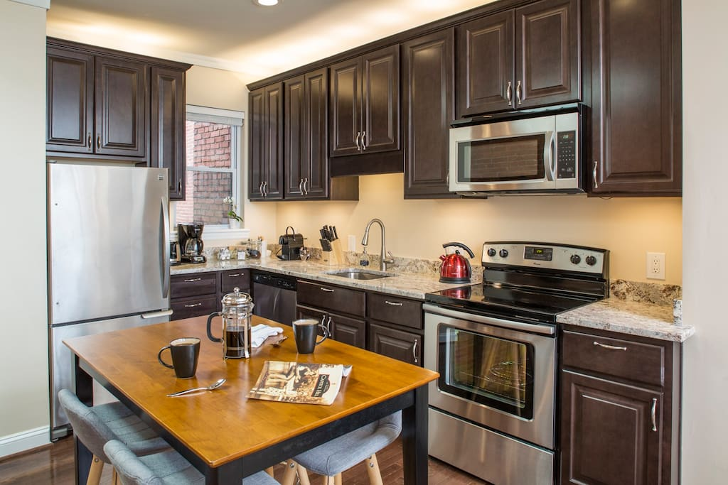 Brand-new kitchen with all stainless steel appliances and dining area