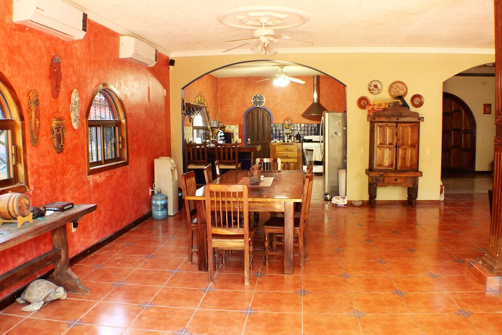 Spacious dining area with large, hand made table which seats 8. The room also has 2 Air conditioning units.