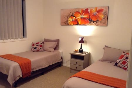 Large bedroom with 2 single beds. - Lennox Head
