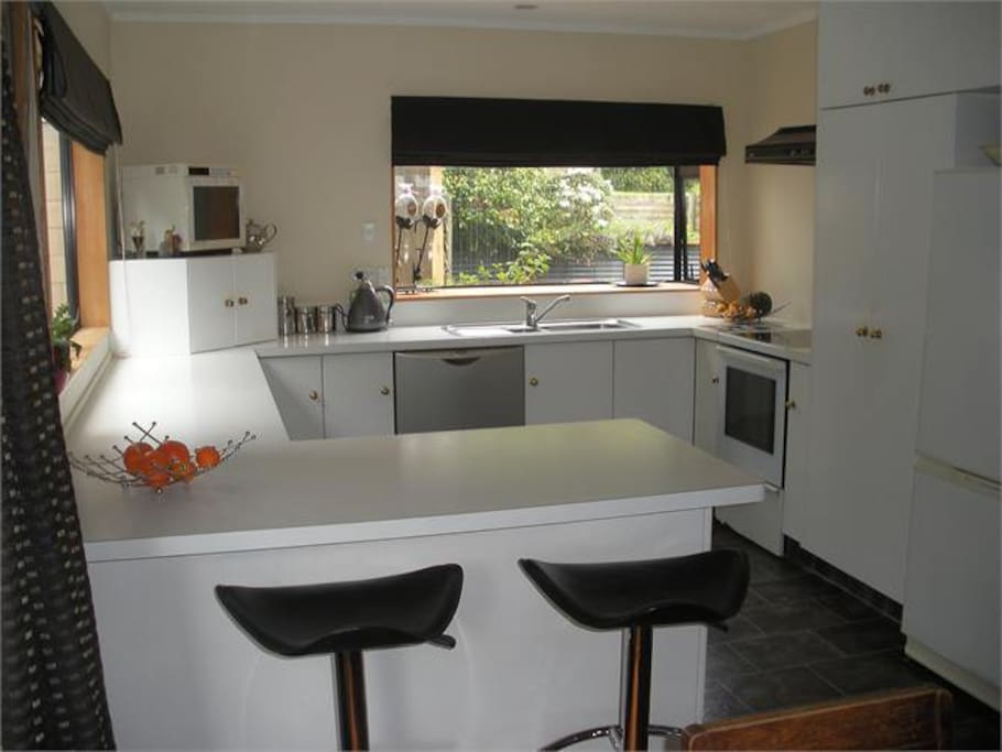Fully equipped modern kitchen for your use.