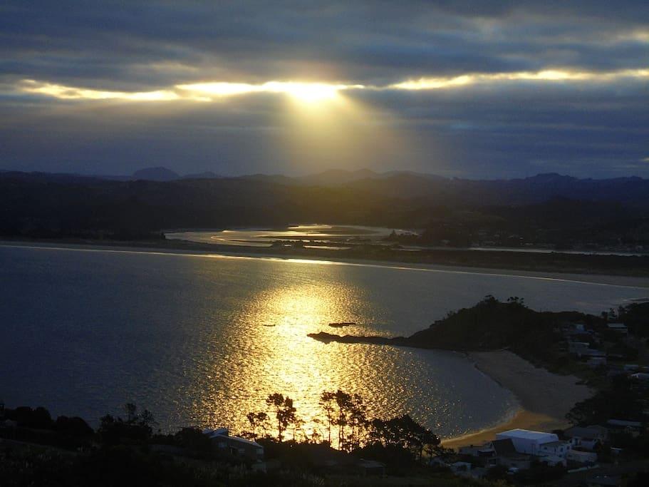 Sunset from caravan overlooking Wellington's bay and Ngunguru