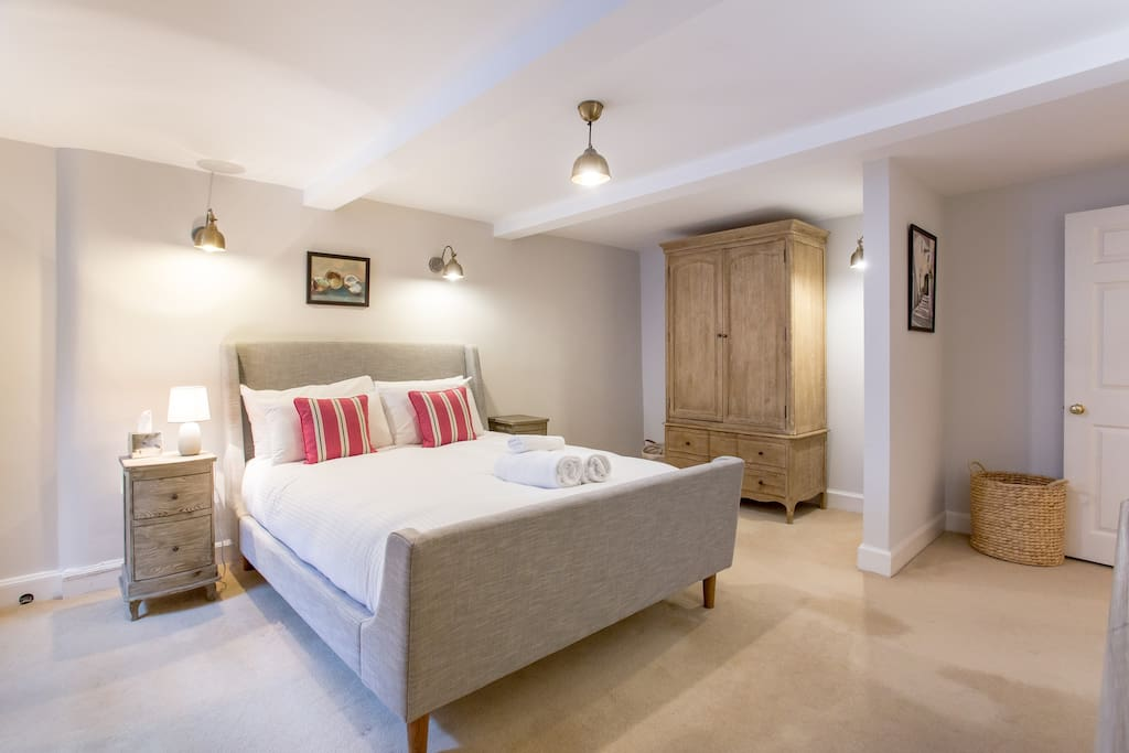 Master bedroom with Sleigh bed and luxury mattress