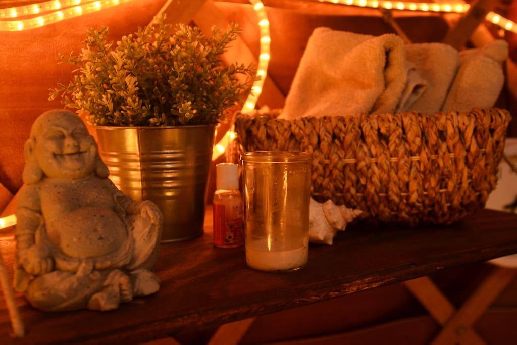 hand or face towels and candles scattered about.