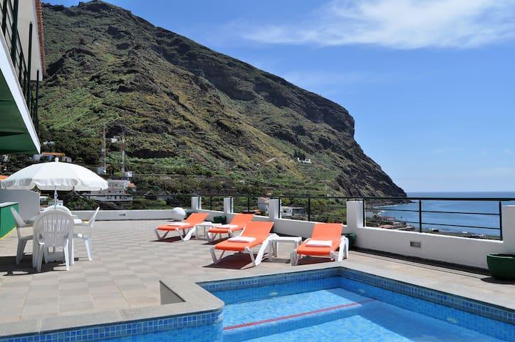 Spectacular views, heated pool, sauna.