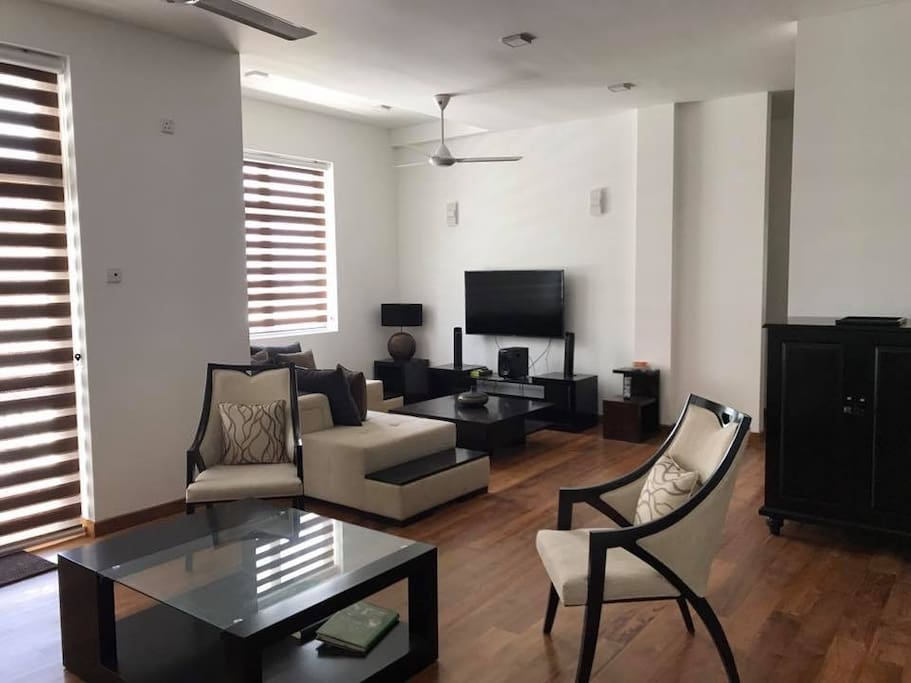 """Spacious TV Lounge, with Wi Fi, Telephone, 58"""" TV with satellite connection, Bar cabinet and private entrance to the Gymnasium, Common Roof top with meeting room and sitout facilities"""