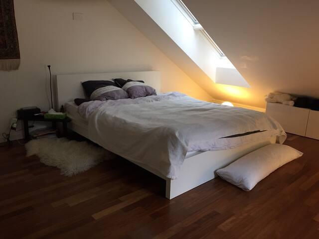 Bedroom with king-size bed and five-door wardrobe