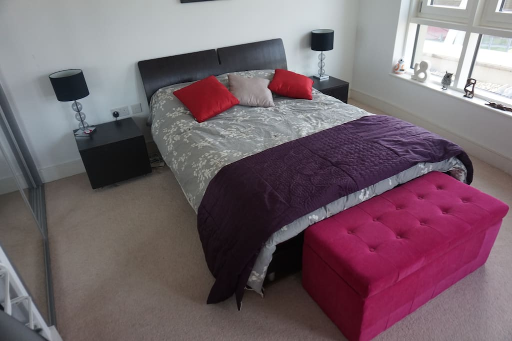Large modern spacious bedroom with comfy double bed, and memory orthopedic mattress.