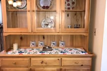 Dining room hutch with glass doors holds dishes