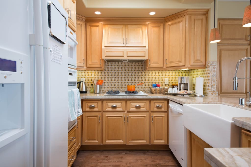 Open, bright kitchen with natural lighting. Feel free to cook - all appliances you might need are provided! (4-burner gas stove, refrigerator, microwave, oven, toaster oven, electric kettle, coffee maker).