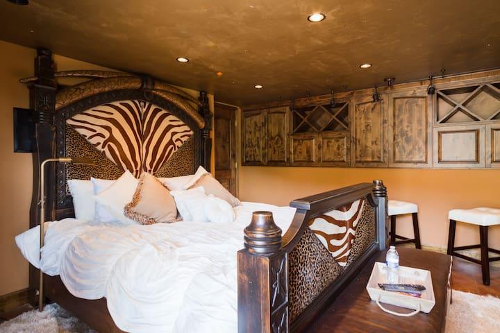 Safari room, lower level of pool house, plush King Bed