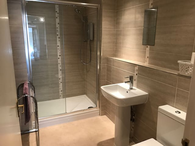 Large modern bathroom with walk in shower