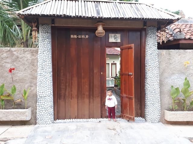 My son at the main entrance, high fence around for privacy.