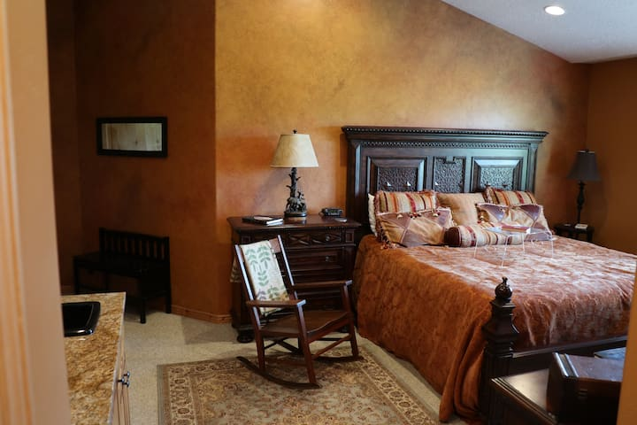 Upstairs bedroom 1 - lock out  w/ fireplace  and en-suite bathroom - king