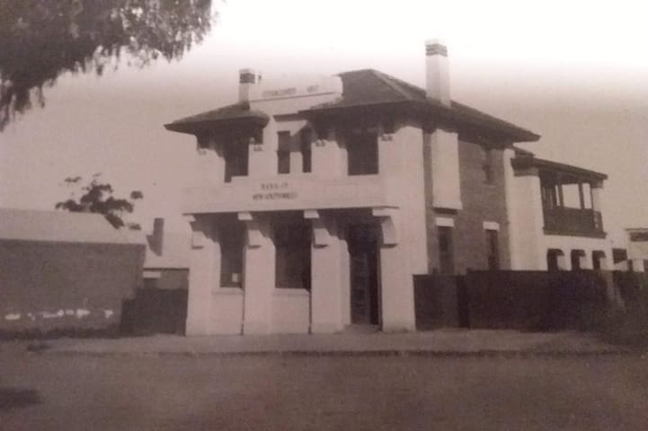Early Photograph of original building prior to bank extension.