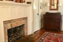 Original 1801 Federal mantle, bricks crafted on site.