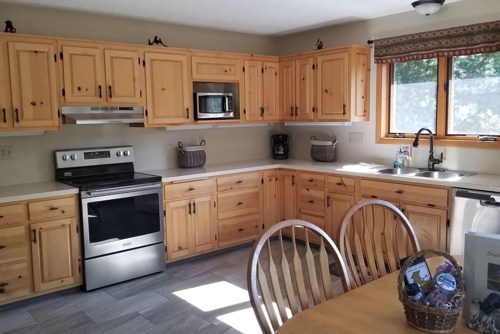Fully equipped kitchen with new stove, dishwasher, and microwave