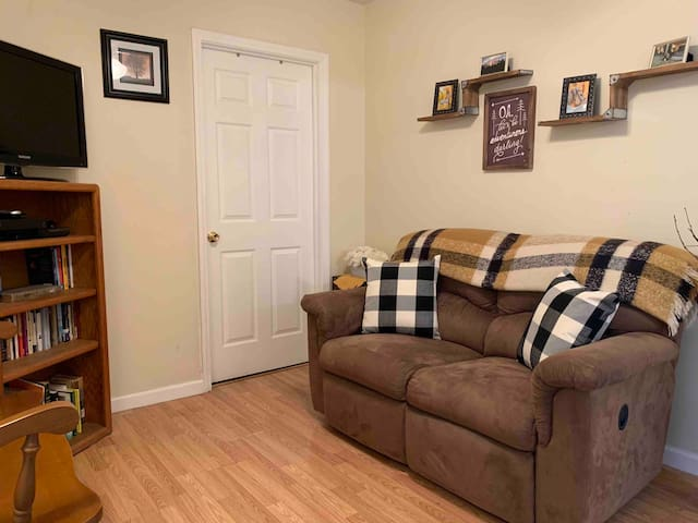 Double recliner for the nights you want to stay in and relax with cable TV and wi-fi access for Netflix