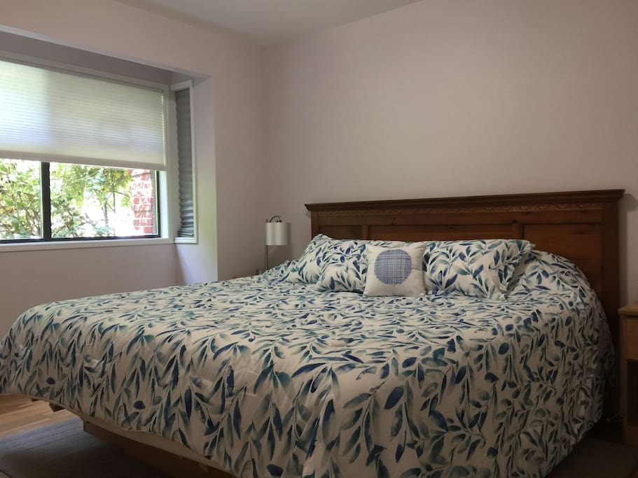 Sleep in king size luxury all natural latex bed with a large rose bush outside your bedroom window