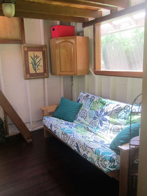 Downstairs futon couch opens to a full bed