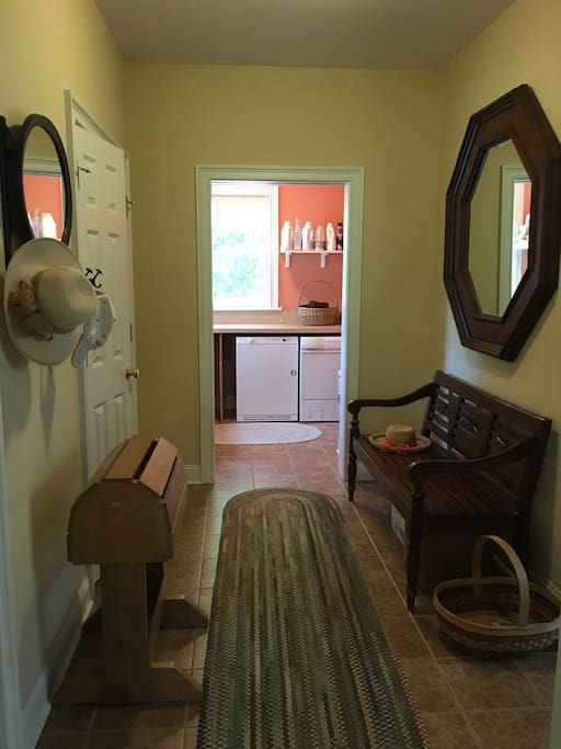 Garage entrance into mudroom and laundry room