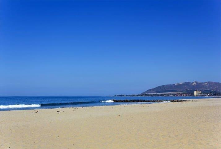Beach side duplex steps to the sand
