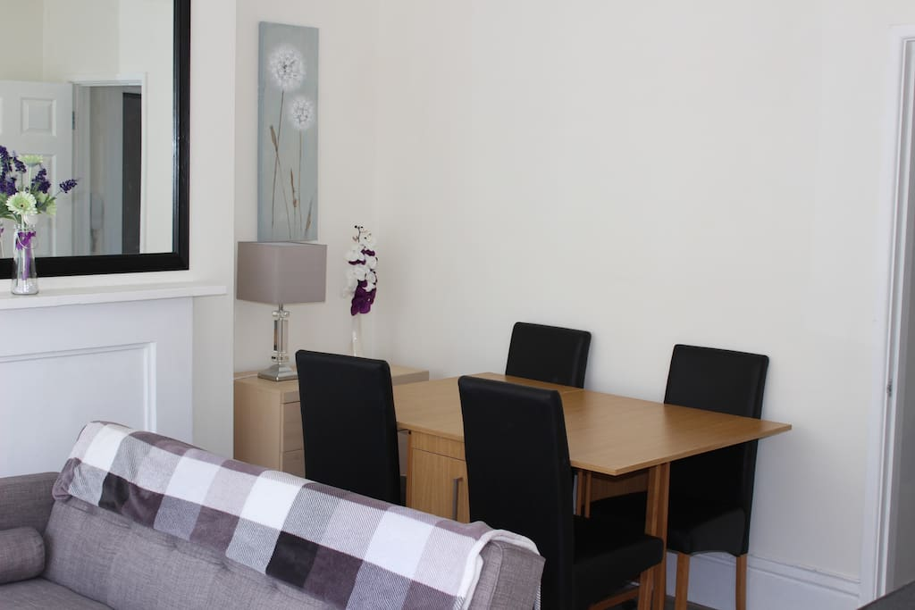 The dining area and drawers where he sofa bed bedding is.