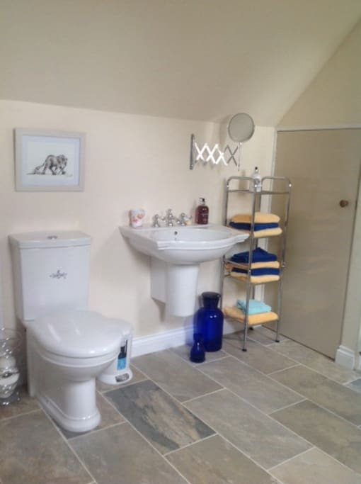 Brand new high spec bath and shower including fresh towels and hair dryer.