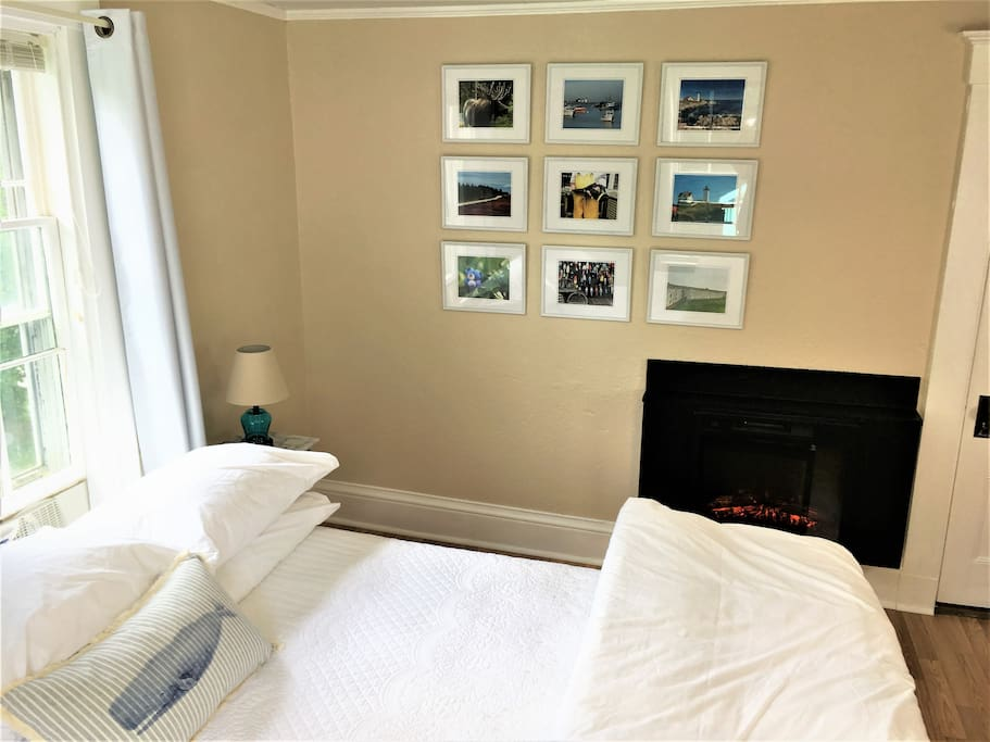Master bedroom,  romantic easy to operate fireplace for your getaway, gallery wall in master bedroom shows images of Maine
