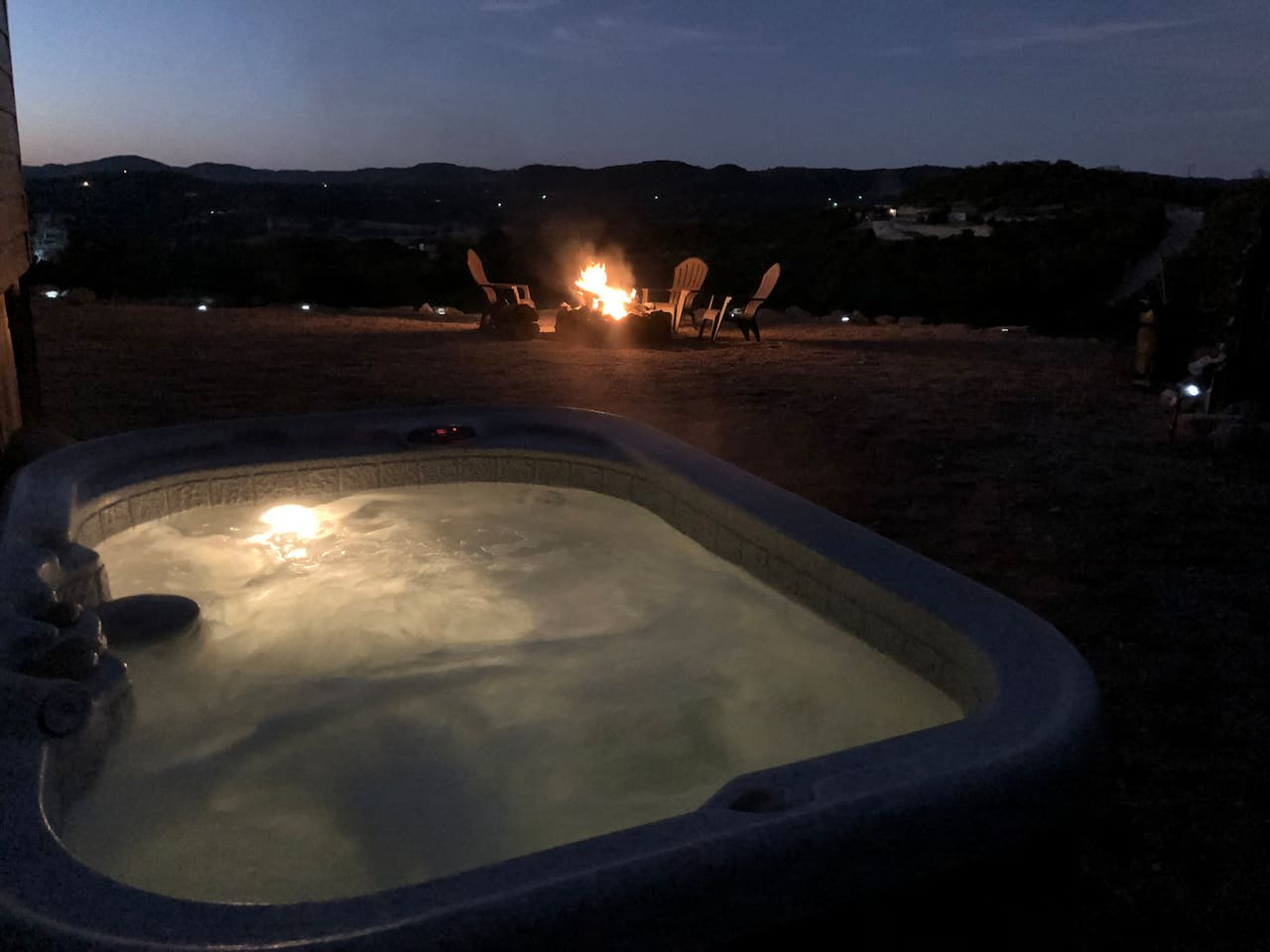 Enjoy beautiful views from our private hot tub 24 hours a day