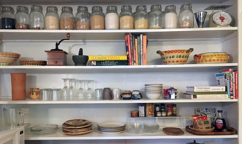 Fully equipped kitchen with international cookbooks for inspiration.