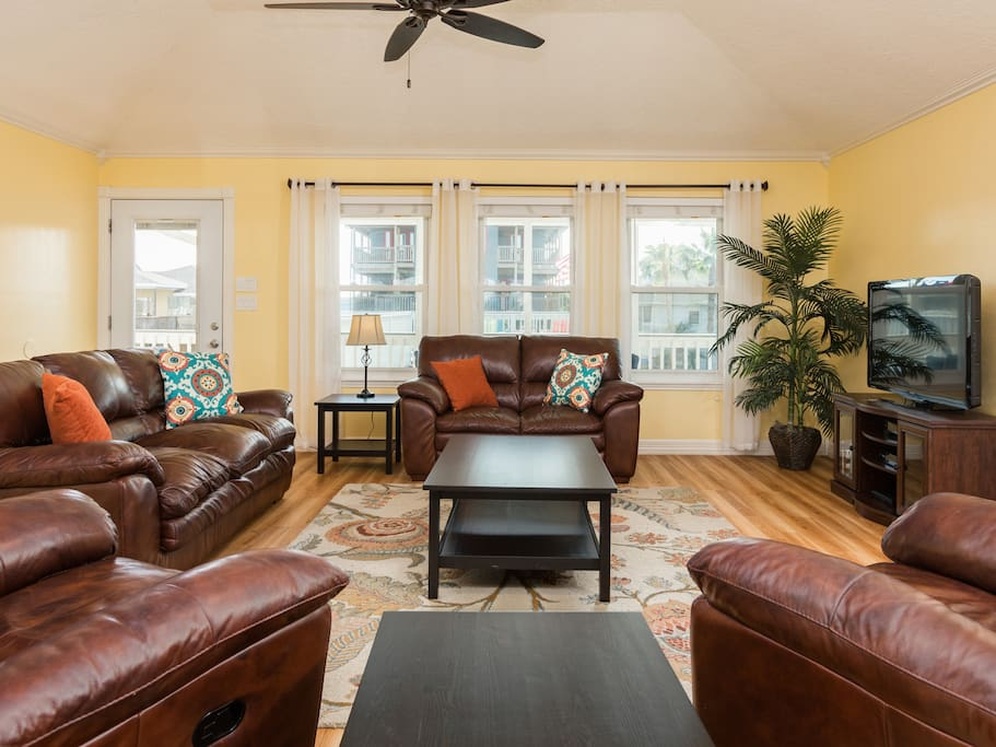Living room w/ leather recliners, sleeper sofa set and HD TV w/ full cable/WiFi.