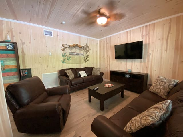 Living room. Includes queen sleeper sofa bed
