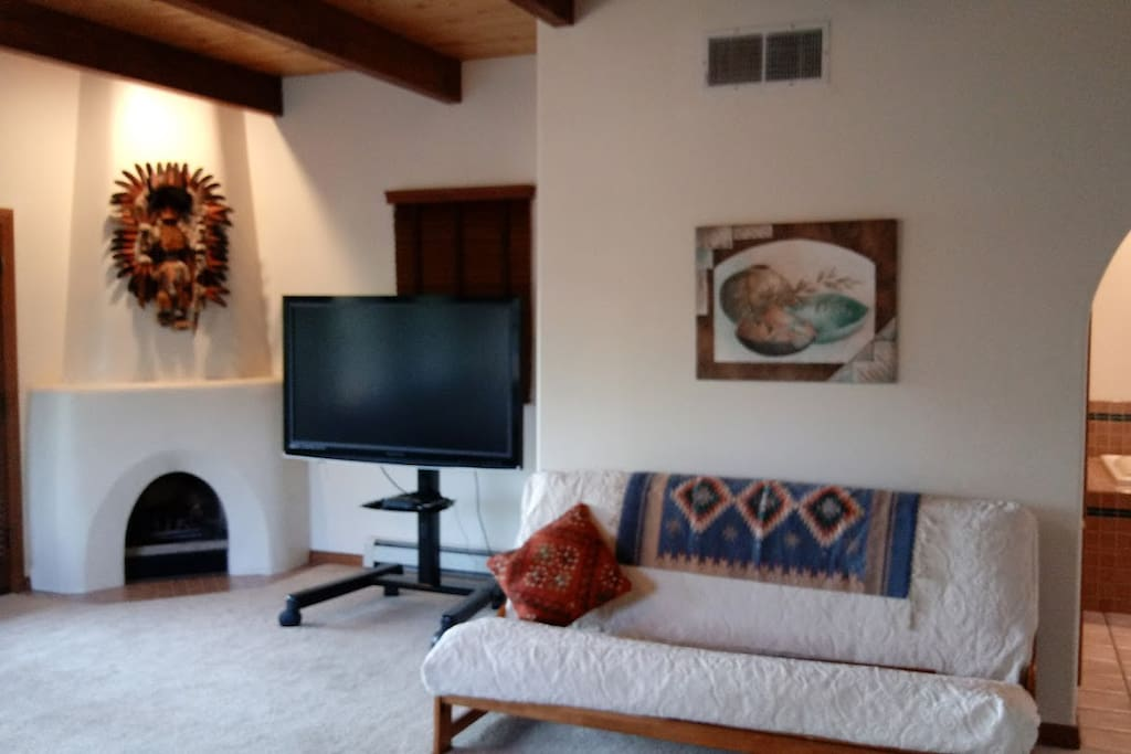 Fireplace, TV with Blu-ray Player & Futon