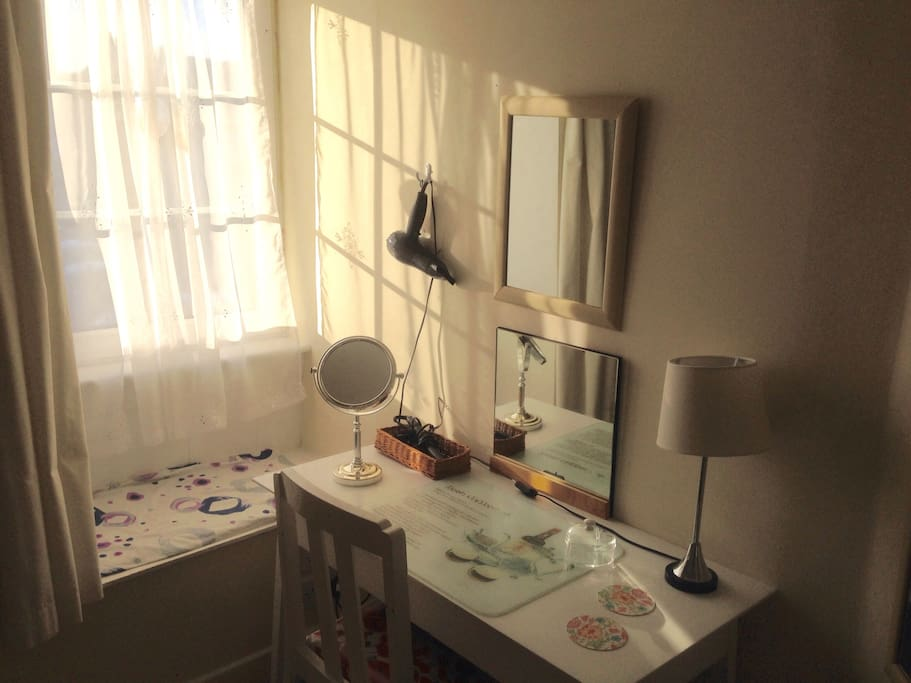 The Dressing Table. The Hair dryer and hair straightener are here.