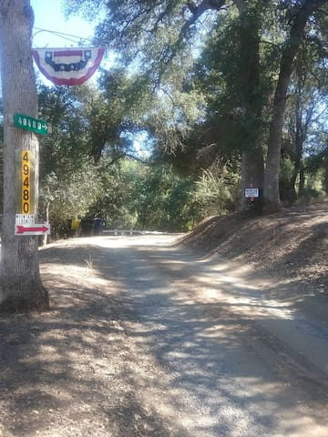 THE DIRT ROAD YOU TURN ON at the end of Greenacre Drive on the right.  Follow this road up to the white mail box. Turn right, right before that mail box up our paved drive way to your private parking spot between the two AIRBNB arrow signs.YOUR HOME
