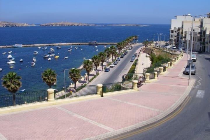 St Paul's Bay promenade with St Paul's island