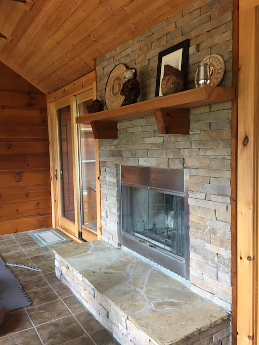 Shared fire place in our screened in porch.