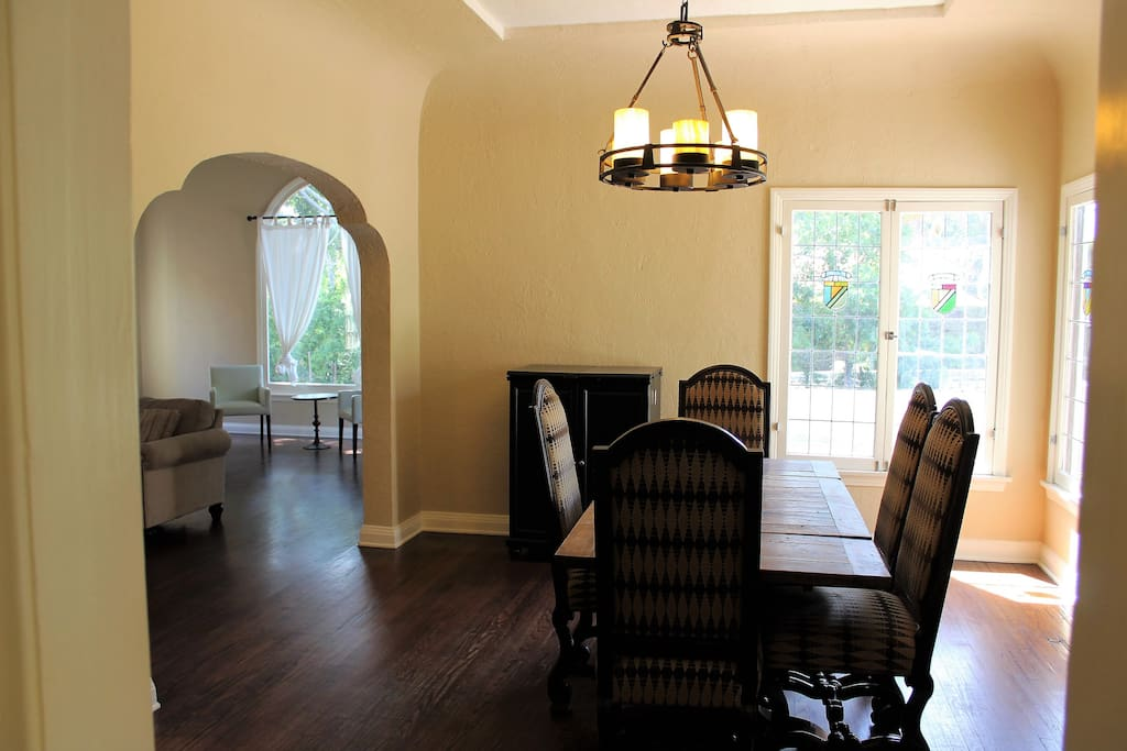 The grand exterior is matched by the grand interior. This dining room area flows and opens up to huge living room area creating a great common area to enjoy with your friends and family.