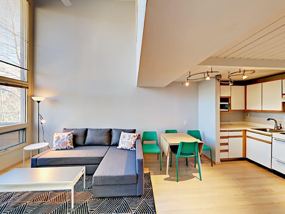 Vaulted ceilings and impressive windows provide plentiful natural light.